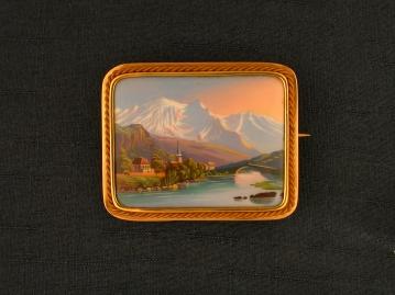 Broche avec paysage de lac et montagnes